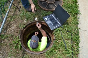 Paul Handke (PA DEP) collecting chlorine samples from a sample tap