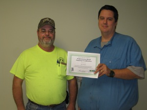 Shawn Whittle (V.A.W. Water) receiving a certificate of recognition from William McClimans (Alabama Department of Environmental Management)