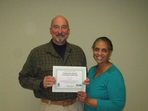 Kevin Tillman (Cullman County Water District) receiving a certificate of recognition from Laura Taylor (Alabama Department of Environmental Management)