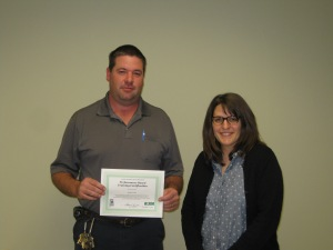 Nathan Finley (Hanceville Water and Sewer District) receiving a certificate of recognition from Alison Dugan (U.S. EPA TSC)