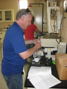 Steven Hoffman (ODEQ) and Jennifer Bunton (IDNR) analyzing water quality samples that were collected during the workshop.